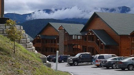 clouds rest on the Smoky Mountains behnd beautiful Westgate Resort cabins before the wildfires in Gatlinburg Tennessee