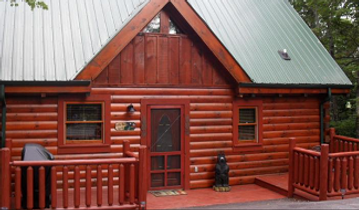 Front entry of cabin named Gotta have Faith