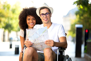 Happy tourist in wheelchair with friend, wheelchair accessible cabins