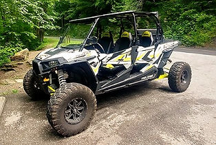 UTV and Jeep Rentals in Pigeon Forge, TN, black and yellow UTV parked in the Smoky Mounains