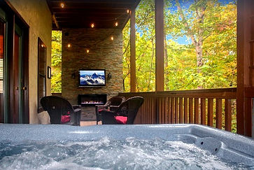 """Cabin named """"Forest Hollow"""" that is near The Island and LeConte Center in Pigeon Forge, Tennessee, outdoor deck view from hot tub"""