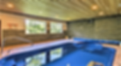 Indoor swimming pool inside of a cabin in Pigeon Forge, cabin rental example
