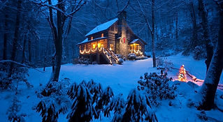 Christmas cabin with lights and snow