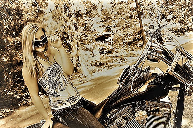 happy biker chick sitting on motorcycle