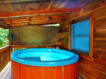 Affordable Gatlinburg cabin called Valerias Beary Tale, hot tub on deck view