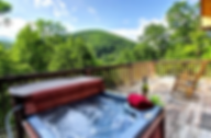 hot tub on the deck with a mountain view