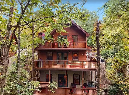 """Cabin named """"Forest Hollow"""" that is near The Island and LeConte Center in Pigeon Forge, Tennessee, exterior view"""