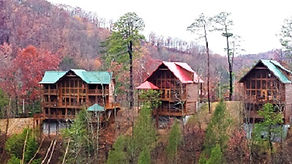 3 cabins in the distance on a mountainside in the Smoky Mountains near Gatlinurg Tennssee