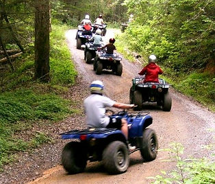 ATV tours in Pigeon Forge TN, line of ATVs on a mountain trail