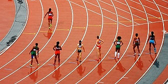 runners on a track competing