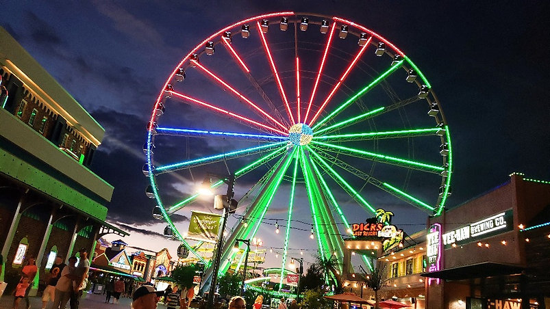 """The Island """"Wheel"""" ride, night view at The Island Attraction in Pigeon Forge, Tennessee"""