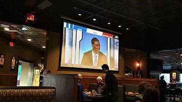 Tv in dining room of restaurant