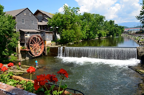 Old Mill Restaurant, Old Mill Sqare, Pigeon Forge landmark, waterfall, wheel, flowers
