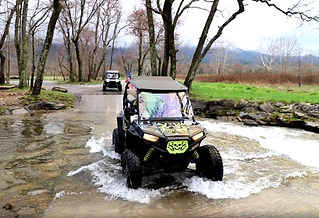 UTV Rental in Pigeon Forge and Sevierville, Mountain Riders UTV riding through water