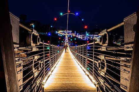Gatlinburg Skybridge Christmas view of walking on bridge with Christmas lights