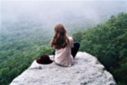Ski Mountain Views, girl sitting on rock in Mountains