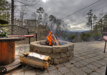 Fire pit at Mountain Recreation Cabin in Pigeon Forge TN, a pet friendly cabin close to Dollywood