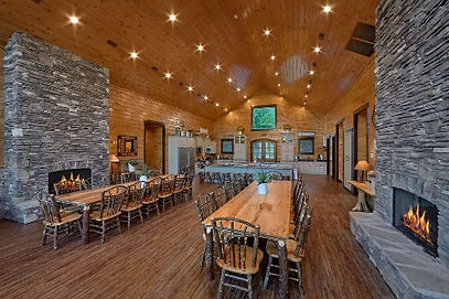 Wildbriar Lodge, dining room and fireplace view of Large cabin rental in Pigeon Forge tn