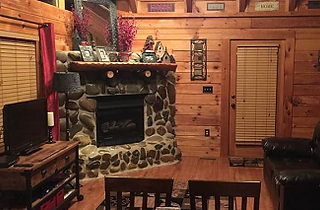stone firplace in Gotta Have Fatih honeymoon cabin in Gatlinburg