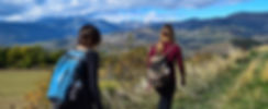Girls hiking with backpacks in the mountains