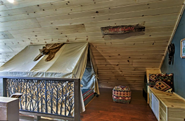 Tent bed in Camp Runamuck Cabin in Pigeon Forge near Dollywood pet friendly and kid friendly