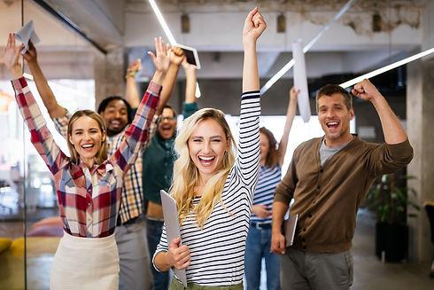 happy-business-people-celebrating-succes