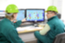 Industrialworkersincontrolroom.jpg