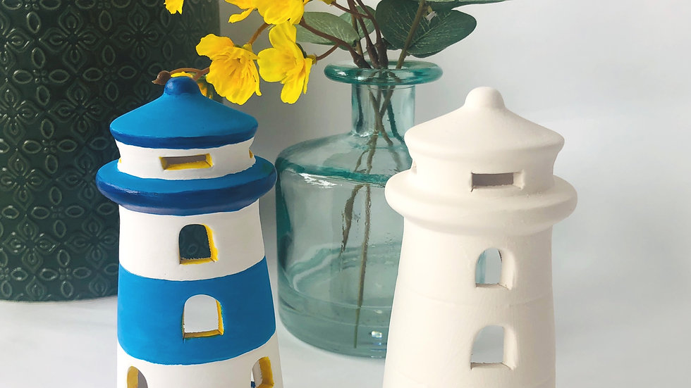 a decorated and an undecorated ceramic lighthouse tea light holder