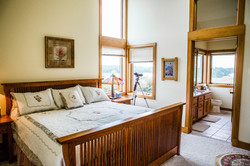 Master suite w view of eagle bay