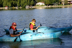 Two kayaks/two canoes/paddleboat