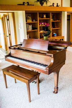 The Steinway grand piano awaits.
