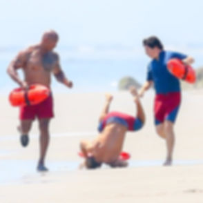 Zac-Efron-Falls-While-Running-Beach-Bayw
