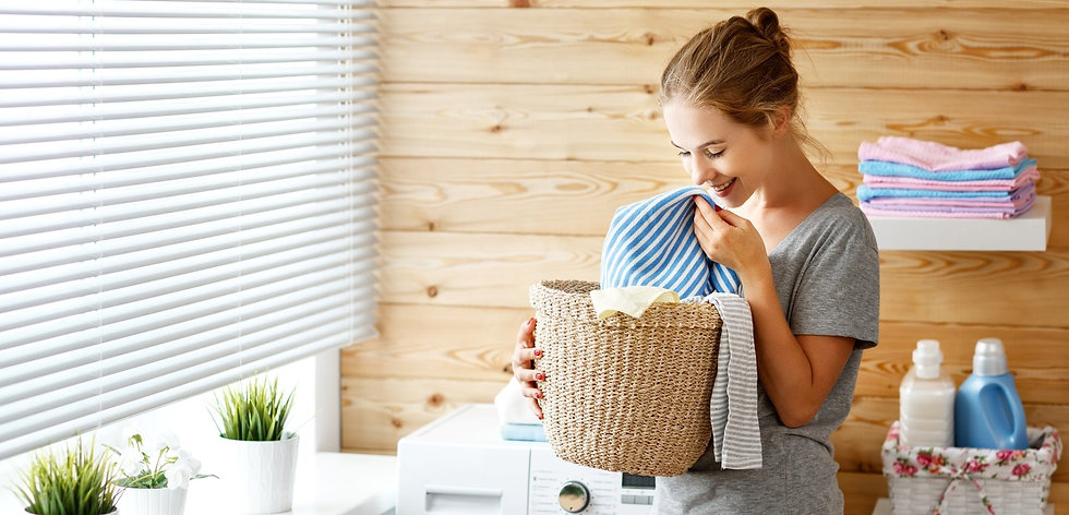 woman-holding-laundry-basket-with-clean-