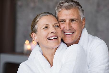 Smiling husband embracing cheerful wife