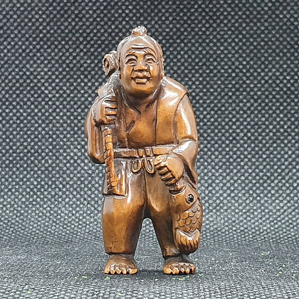 Boxwood netsuke -walking fisherman