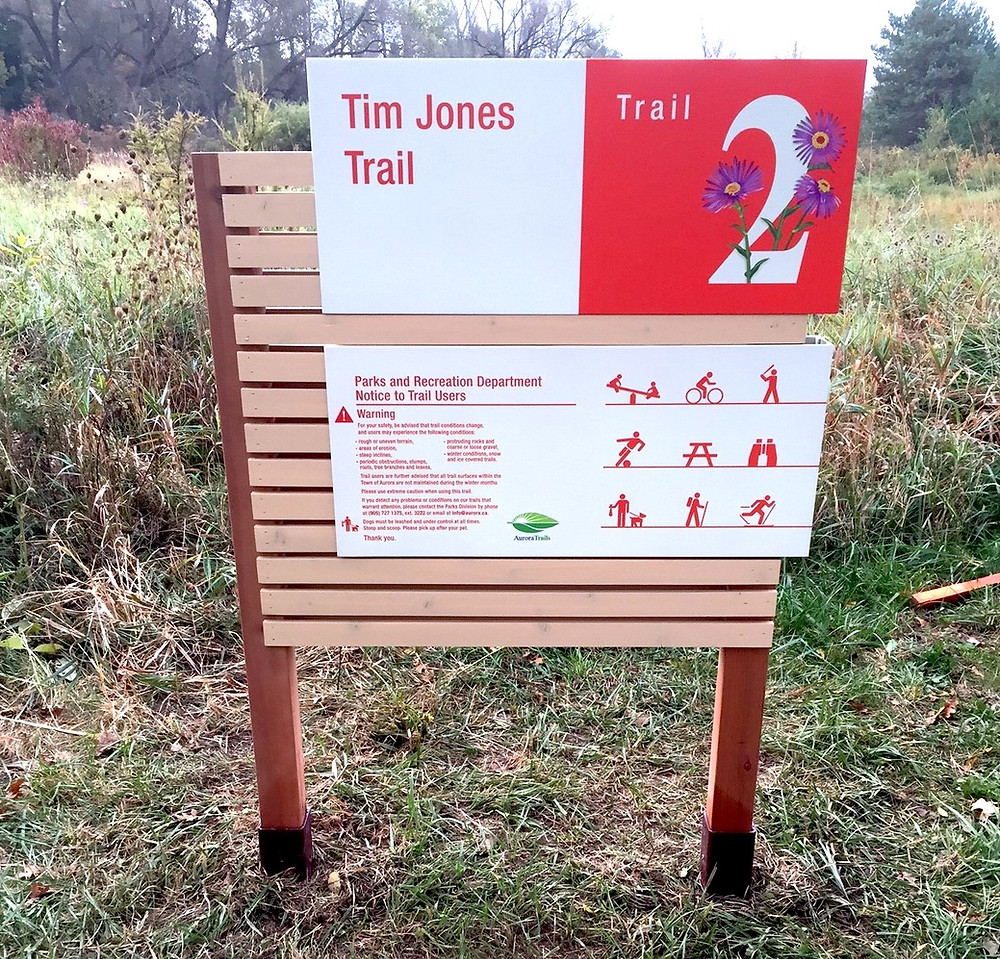red and white signage at trailhead made with powder-coated graphics on aluminum