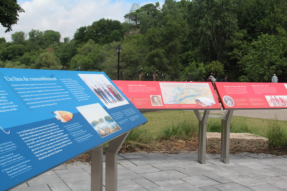 blue and red interpretive panels with custom powder-coated graphics on aluminum