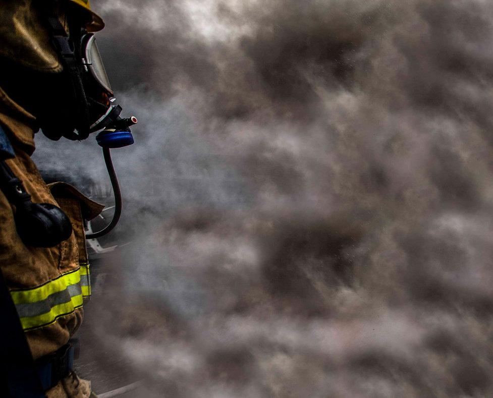 Fire Academy West Valley Utah firefighter in smoke