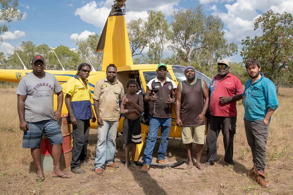 © Brad Leue/AWC - WAC Project Officer Lloyd Nulgit (far left), Wunggurr Rangers and Traditional Owners Kane Nenowatt and Robin Dann together with Traditional Owners and Incendiary Machine Operators Cassidy Charles, Michael Nulgit, Tyron Burgu and AWC Regional Fire Coordinator Toby Barton prior to the joint prescribed burning operation.