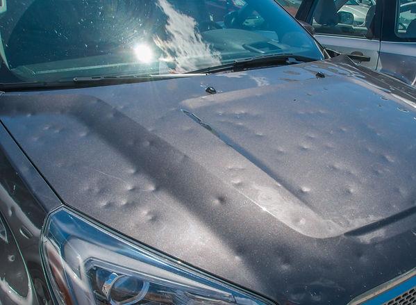 Dented car after a big hail storm.jpg