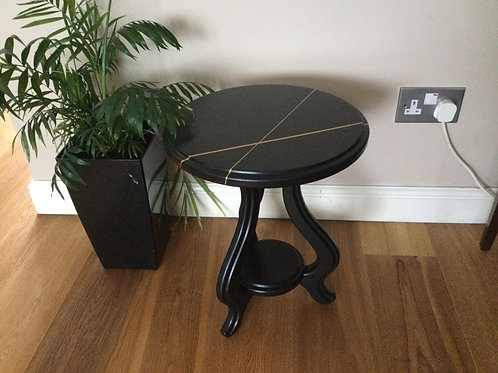 Bespoke small table in black with unique gold detail