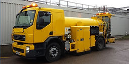 Skid vehicle, a large yellow vehicle with a water tank. Used for asset management for private contractors and local authorities.