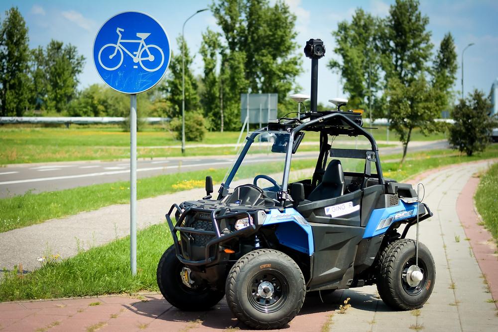 ATLAS Quad Bike Ginger Lehmann and Ginger Lehmann + Partners Visual Inspection highways vehicle. Blue quad bike with 360 cameras on top.