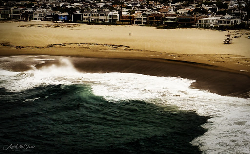 "Southern California coastline shorebreak at the ""wedge"" beach in Newport Beach, aerial drone photograph"