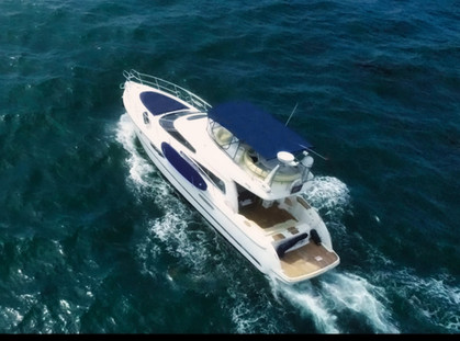 Aerial, drone photograph of a yacht in Dana Point, California