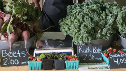 farm stand with fresh vegetables and fruits
