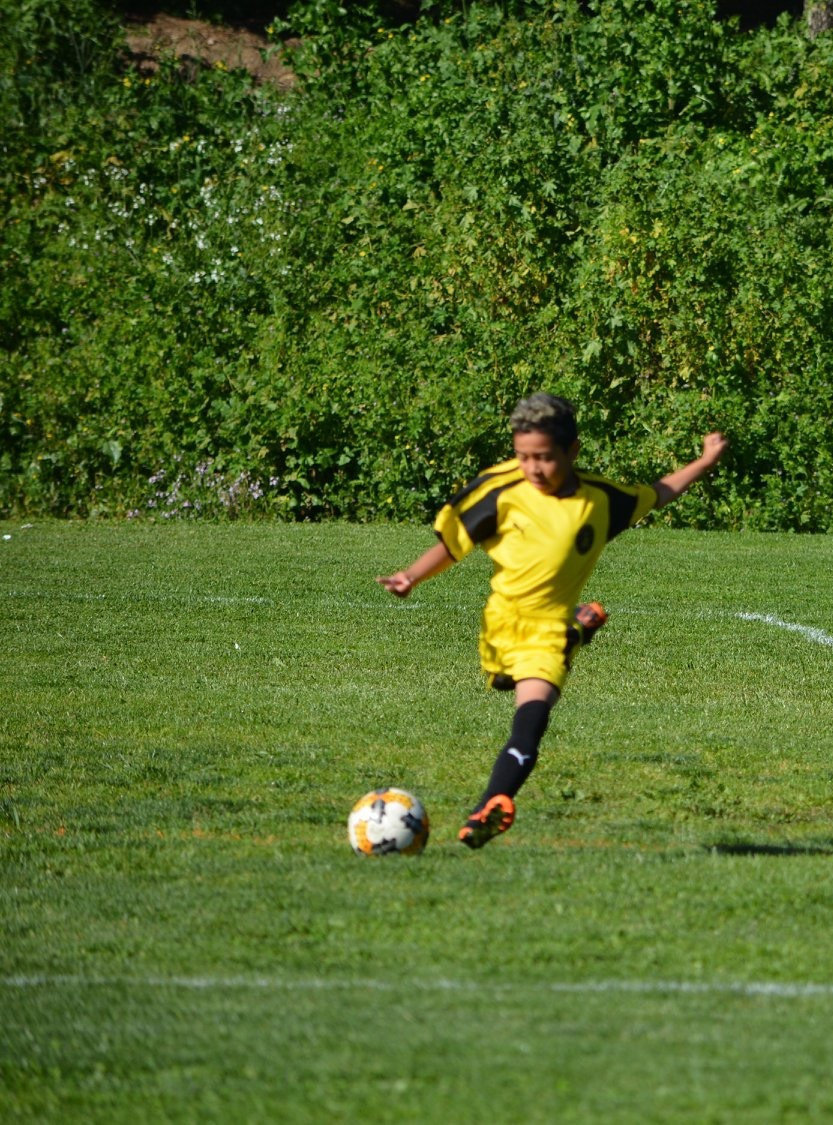 youth playing soccer