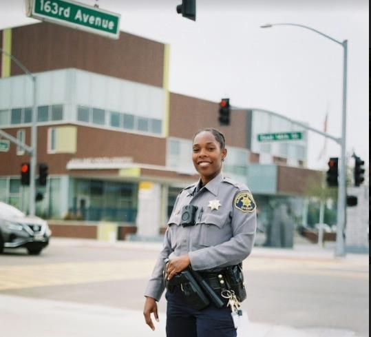 officer smiling on 163rd ave.