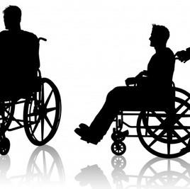 silueta-de-un-hombre-en-silla-de-ruedas_