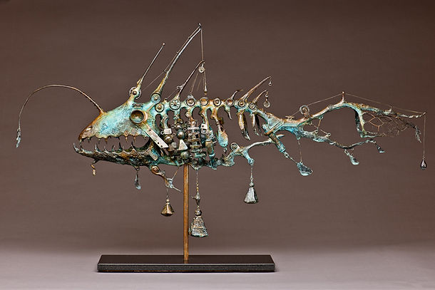 Bronze angler fish sculpture comprised of fishing gear.
